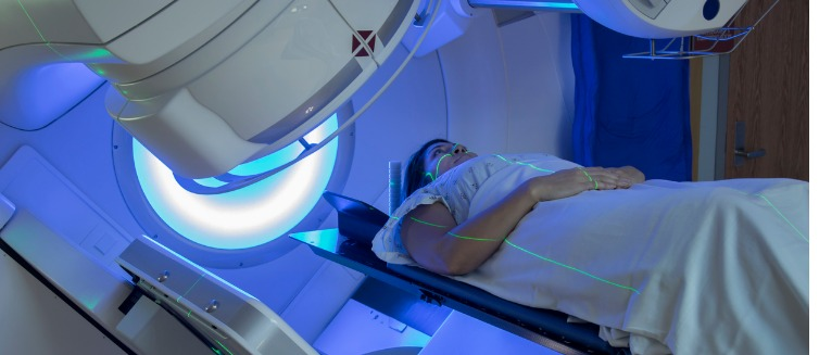 woman-receiving-radiation-therapy-treatments-for-breast-cancer-picture-id613327714